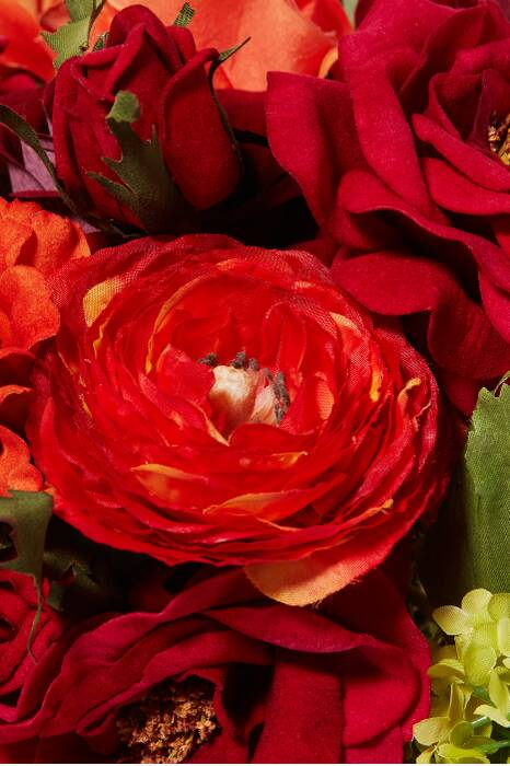 Red and Orange Rose Ranunculus Bouquet with Glass Cube Vase