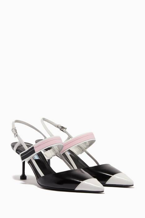 Black & White Buckled Point-Toe Pumps